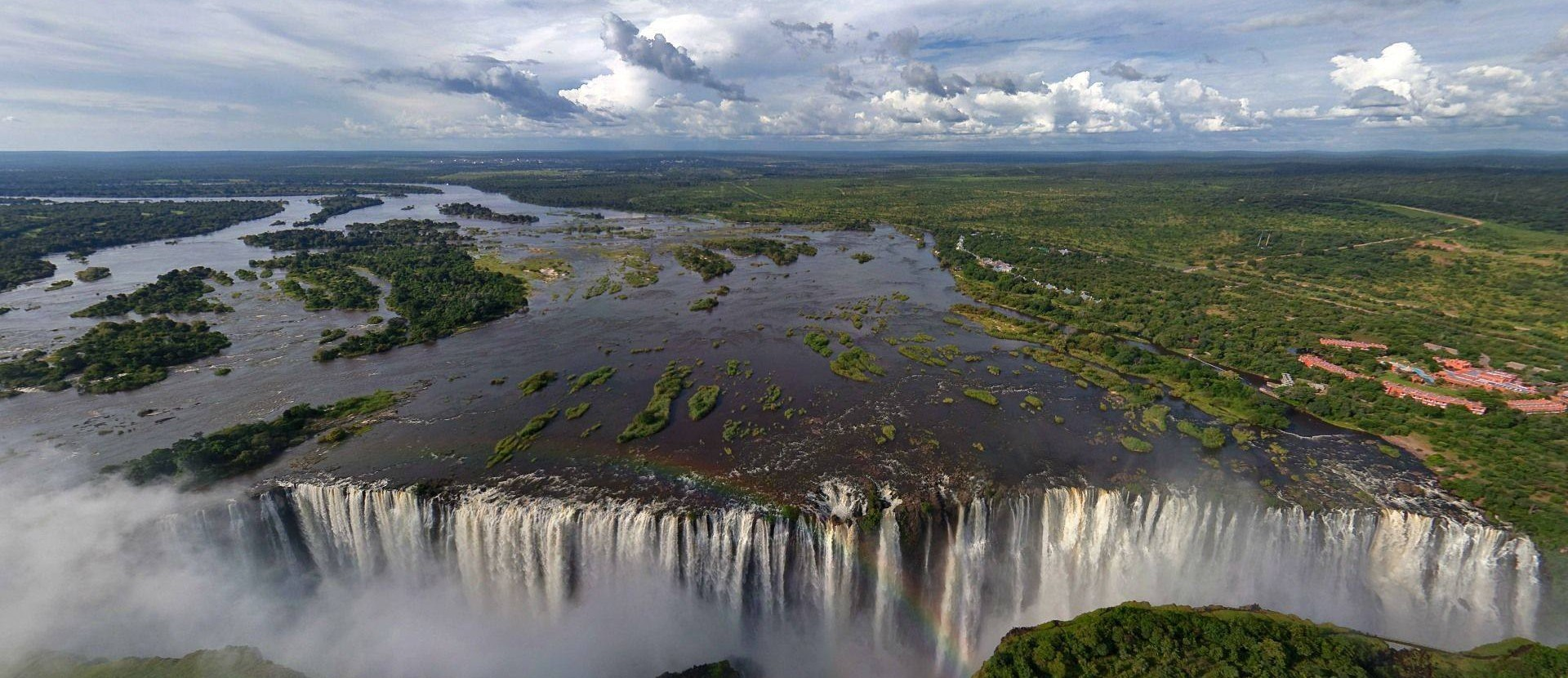 Victoria Falls Is The Largest Curtain Of Falling Water In